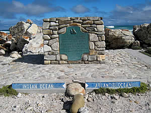 Cape Agulhas (Cape of Needles) is the southernmost point of the continent of Africa and is also the official   dividing point between the Atlantic and Indian oceans although the actual division varies acording to the   fluctuations of the Benguela and Agulhas currents.  Find Agulhas accommodation on our Agulhas accommodation page.