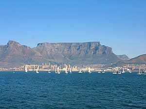 The 'classic' view of Table Mountain and the city of Cape Town with a yachting regatta taking place in Table Bay.  Find Blouberg Capetown accommodation convenient for beaches, water sports and views of Table Mountain on our Blouberg Cape Town accommodation page.
