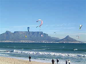 Kite surfing in Table Bay with Table Mountain in the background; another popular water sport off Blouberg's beaches.  Find Blouberg Capetown accommodation convenient for beaches, water sports and views of Table Mountain on our Blouberg Cape Town accommodation page.