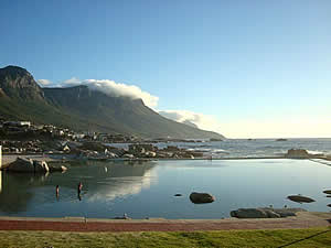 The tidal pool at Camps Bay where you can swim and enjoy the view.  Find Camps Bay Capetown accommodation with its beaches and sunshine on our Camps Bay Cape Town accommodation page.