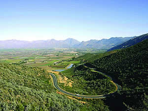 The Ceres valley from Mitchells Pass.  Fertile, with good rainfall and warm summers, Ceres is a major source of deciduous fruit, especially cherries, and is famous world-wide for its own exported brand of fruit juices.  Find Ceres accommodation on our Ceres accommodation page.