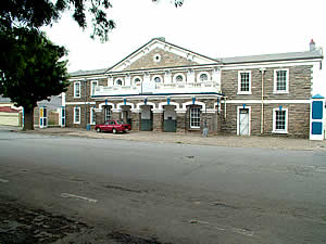 The drill hall of the First City Regiment, raised in 1875 from volunteers in the city.  Grahamstown was the principal military base during the earlier Frontier Wars involving the British and the Xhosa and was itself once heavily attacked.  The regiment has accumulated 18 battle honours. Find Grahamstown accommodation on our Grahamstown accommodation page.