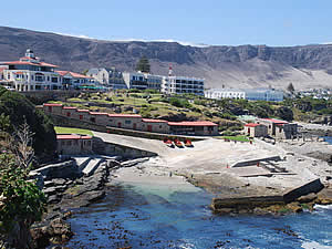 Hermanus, the old harbour.  Hermanus is a village squeezed between the sea and the mountains, creating a scenic location that has charmed visitors since its founding.  The village has grown hugely since then but has managed to retain its atmosphere.  Find Hermanus accommodation on our Hermanus accommodation page.