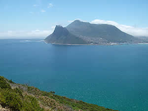 The Sentinel overlooking Hout Bay and the village clustered around the bay and up the hillside.  Find Hout Bay Cape Town accommodation on our Hout Bay Cape Town accommodation page.