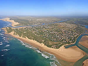 Kenton-on-Sea is a holiday village situated between two rivers, the Bushmans (the far side) and the Kariega (the near side), with a proclaimed nature reserve in between.  The area boasts massive beaches in both directions.  Find Kenton accommodation on our Kenton accommodation page.