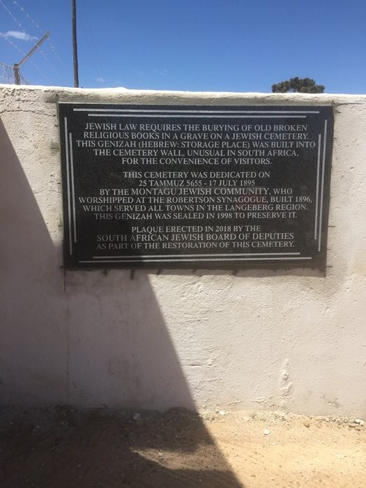 Plaque erected in 2019 on the geniza wall