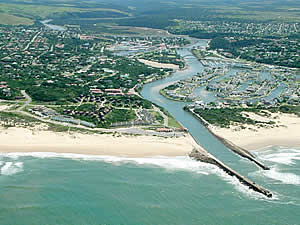 Aerial view of Port Alfred showing on the right the popular marina offering access to both the Kowie River and the ocean as well as a choice waterside lifestyle.  Find Port Alfred accommodation on our Port Alfred accommodation page.