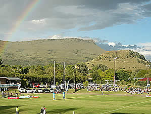 Queenstown is situated between several ranges of mountains.  Here a game of rugby takes place against a backdrop of Long Hill.  Find Queenstown accommodation on our Queenstown accommodation page.