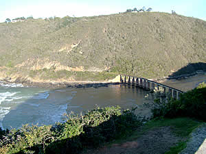 The railway bridge over the Kaaimans River at Wilderness.  The line used to link George with Knysna and was used   by the Outeniqua Choo Tjoe which was the last remaining continually-operated passenger steam train in Africa   until it ceased operation in 2009.  Find Wilderness accommodation on our Wilderness accommodation page.