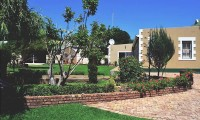 garden_view_of_oliviers_rust_self_catering_apartments_de_rust.jpg