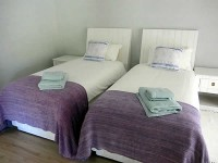 twin_bedroom_at_lupela_lodge.jpg